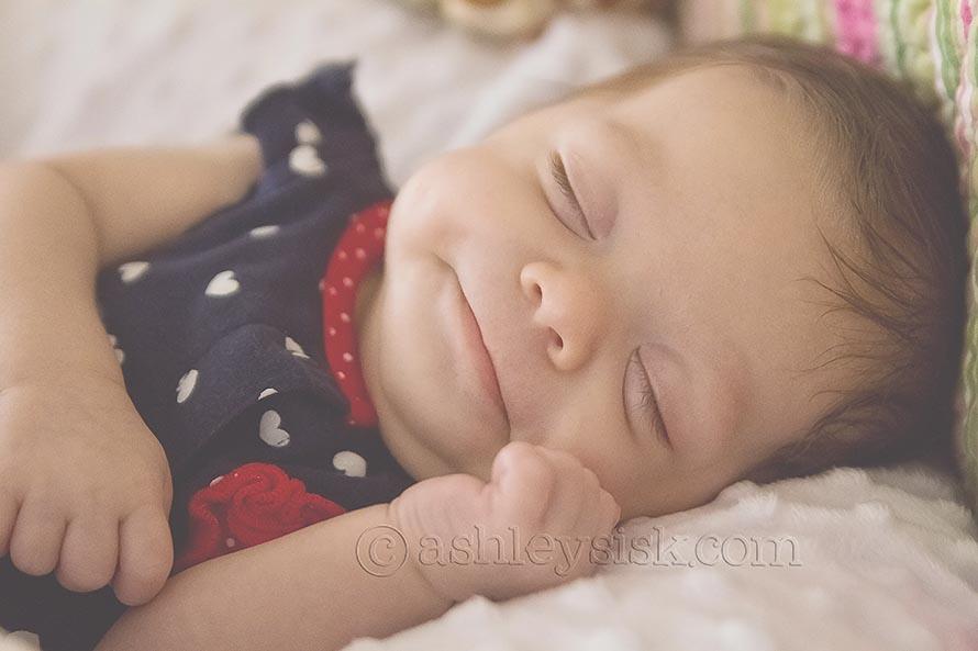 Felicity smiles in her sleep